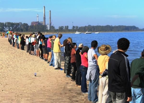 Clean Power Waukegan hands across the sand_sq_09-28-14_docsize