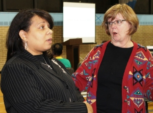 Illinois State Representative Rita Mayfield speaks with Waukegan resident Maryfran Troha at Clean Power Lake County's Clean Jobs Forum in Waukegan on April 8. [Photo by Karen Long MacLeod/Clean Power Lake County Campaign.]