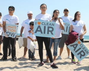 Students with clean air and climate action signs